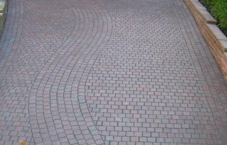 Natursteinpflaster aus rotem Granit Oberfläche geflammt